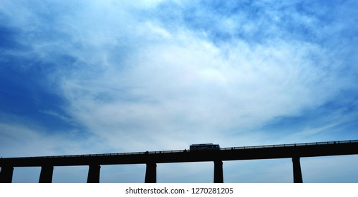 Wide angel shot of High way bridge in India, Ble sky with drametic could.