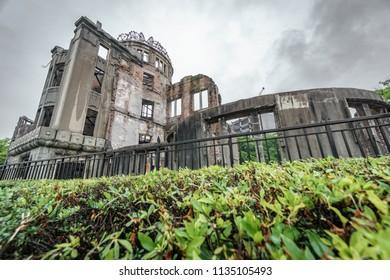 Wide angle bottom view of Hiroshima Bomb Dome and bush, Japan