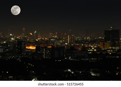 Wide angle of city scape at night scene with super moon