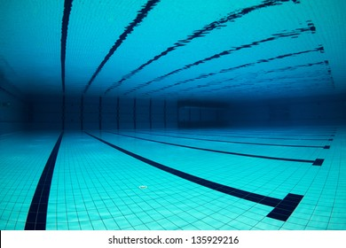Wide angle of an empty swimming pool underwater / Empty Swimming Pool Underwater