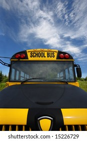 Wide angle front view of a school bus.