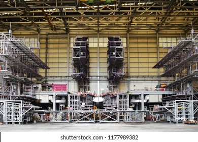 Wide angle front view of steel beam dock in aircraft(airplane) hangar .Aircraft (airplane) hangar construction. Empty Airplane (aircraft) maintenance hangar stand by for maintenance and repair .