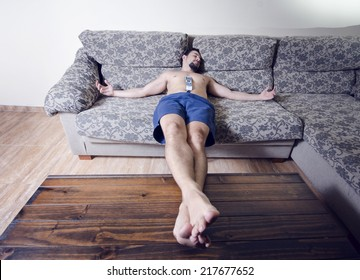 Wide angle image of man resting at sofa with  religious position,