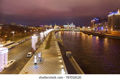 Wide angle landscape view of night Kremlin and Moskva river with Christmas illuminated decorations