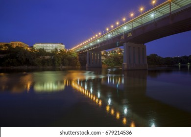 A Wide Angle Long Exposure of The University of Minnesota's Washington Ave Bridge and Bruininks Hall Reflected in the Mississippi River at Dusk