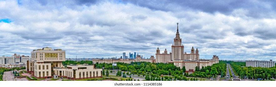 Wide angle long panoramic view of Moscow university campus under dramatic sky with stormy clouds in spring