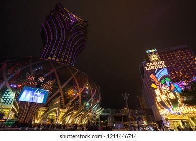 Wide angle night cityscape with Grand Lisboa and Casino Lisboa in Macau, the gambling capital of Asia. Macau, January 2018