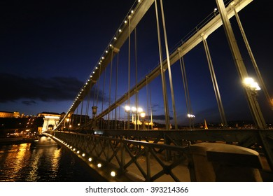 Wide angle night shot of the Chain bridge in Budapest.