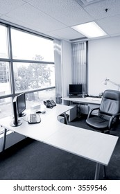 wide angle of office desk in blue tone
