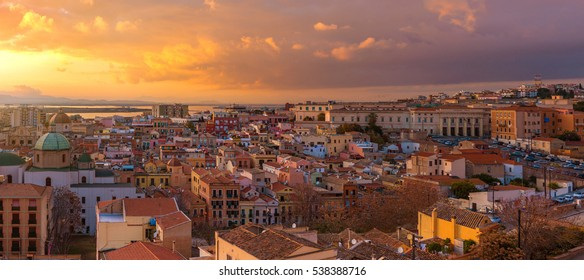 Wide angle panorama of Cagliari old city center during the sunset, dramatic sky above the biggest city of Sardinia, Italy