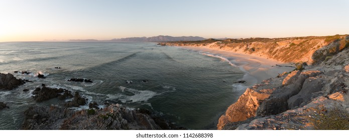Wide angle panoramic view over the walker bay nature reserve along the overberg coastline in south africa