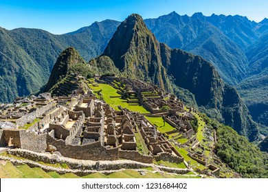 Wide angle photograph of the Lost City of the Inca, the ruin of Machu Picchu, on a sunny summer day located near Cusco, Peru.