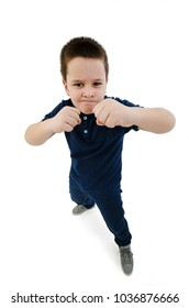 Wide angle,  Serious White Fighter Male Kid Posing with Closed Fists While Looking at the Camera. Isolated on White Background