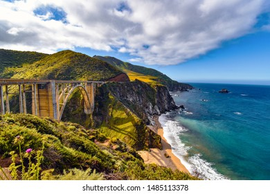 Wide angle shot of the Bigsby Creek Bridge and Pacific Ocean at Big Sur, California