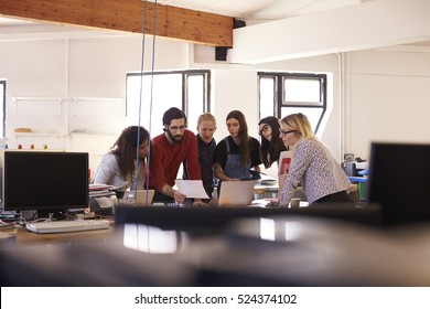 Wide Angle Shot Of Designers Brainstorming In Office Meeting