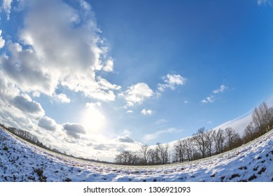 Wide angle shot of a field in winter.