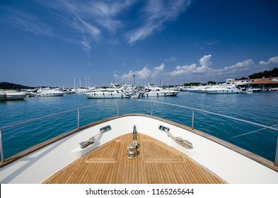 Wide angle shot of front of the yacht in marina on clear summer day