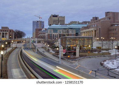 A Wide Angle Shot of a Light Rail Train Passing through the University of Minnesota Campus during a Twilight Long Exposure