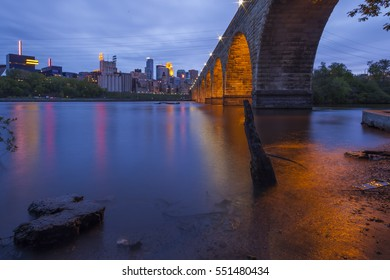 Wide Angle Shot of the Minneapolis Skyline, Mississippi River, and Iconic Stone Arch Bridge during Blue Hour