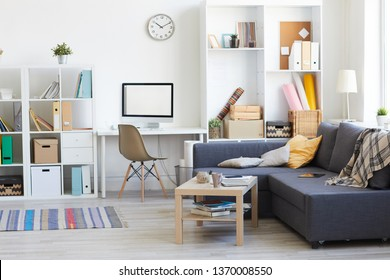 Wide angle shot on domestic interion in white and blue with home workplace in living room, copy space