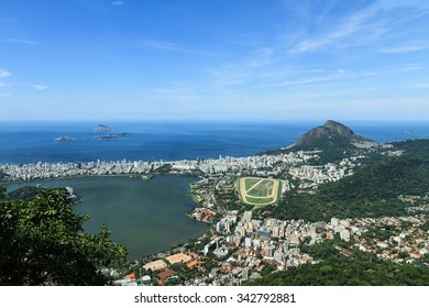 Wide angle shot of Rio de Janeiro taken from the railway ascending to the peak of Corcovado mountain and looking South towards Copacabana. Morro Dois Irmãos is visible in the background.
