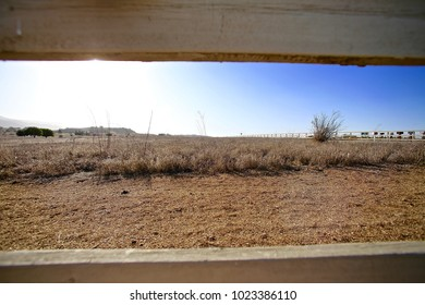 Wide Angle shot through a post and rail fence of  a parcel of yet to be irrigated land