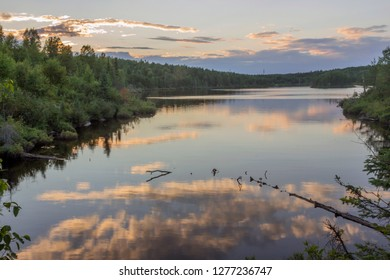 A Wide Angle Sunset Landscape of Juno Lake Reflecting a Colorful Sunset in the Boundary Waters Canoe Area Wilderness of Northern Minnesota