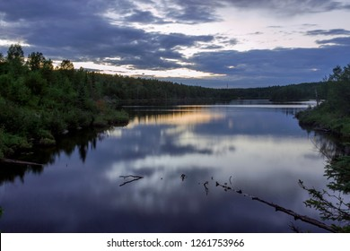 A Wide Angle Sunset Long Exposure of a Boundary Waters Landscape Reflecting in Juno Lake during a Summer Twilight