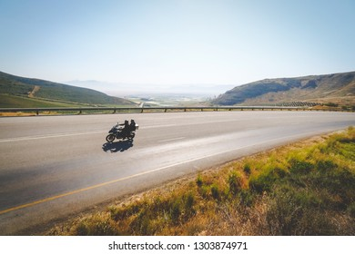 Wide angle view of an adventure bike rider enjoying the open road in the western cape of south africa