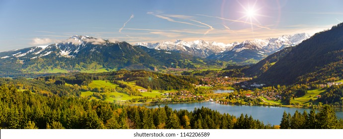 wide angle view to alps mountain range nearby lake Alpsee in region Allgaeu in Bavaria