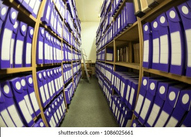 Wide angle view at archive room and storage with papers documents and blueprints