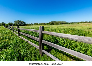 A Wide Angle View of a Beautiful Old Wooden Fence in a Field with a Texas Wildflowers