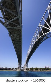 Wide angle view of the the Bluewater Bridge from underneath crossing into Port Huron, Michigan from Point Edwards, Ontario.