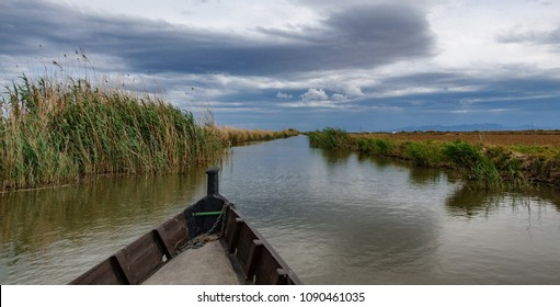Wide angle view of boat and canal towards Albufera, Valencia, Spain