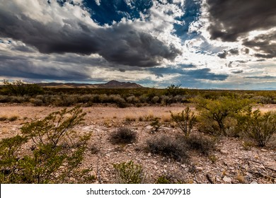 Wide Angle View of the Deserts of Western Texas with Rocky Hills and Storm Clouds in the Background.