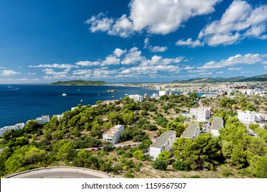 Wide angle view of Eivissa and Playa d'en Bossa Beach , Spain. High angle view with boats on the ocean