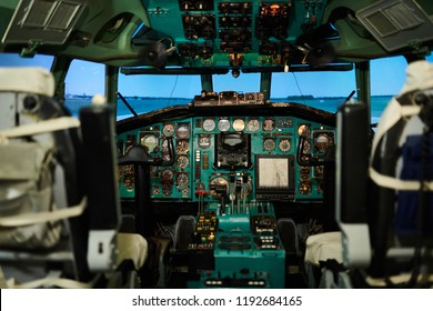 Wide angle view at empty jet cabin with meters and switches on control panel, copy space