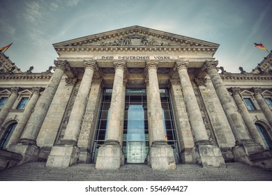 wide angle view of the entrance of the Reichstag building, seat of the German Parliament (Deutscher Bundestag), Berlin, Germany, Europe, Vintage filtered style