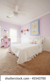 Wide angle view of a girl's bedroom. Vertical format.
