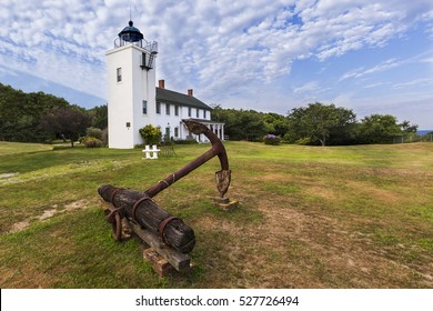 Wide angle view of Horton Point Lighthouse and rustic anchor.