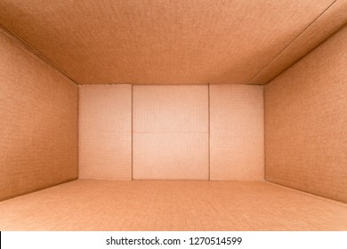 Wide angle view inside large rough cardboard box