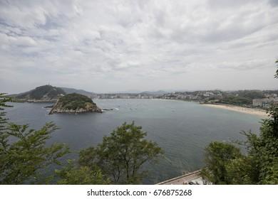 Wide angle view of La concha bay in Donostia (Guipuzcoa, Basque country, Spain).