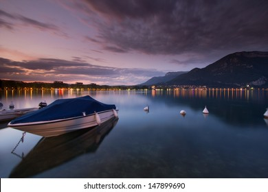 Wide angle view long exposure of a boat on Lake Annecy, France, at sunset.