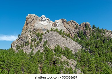 Wide angle view of Mount Rushmore national monument with surrounding forest and nature, Rapid City, South Dakota, United States of America, USA.
