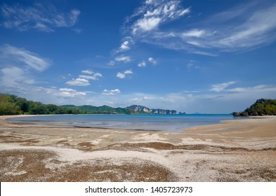 Wide angle view of the Northwestern end of Nopparat Thara Beach in Ao Nang with with Koh Khao Sam Nuai in the background, Krabi province, Thailand.