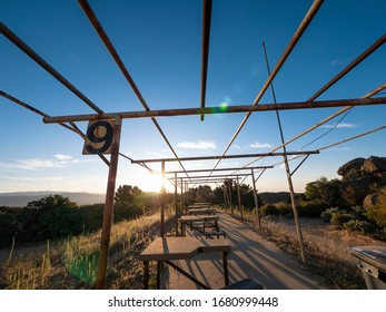 Wide angle view of an old outdoor vintage shooting range in the early morning.