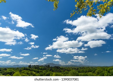 Wide angle view on the blue sky with small dynamic clouds and the mountain in Arcangues. Basque country of France.