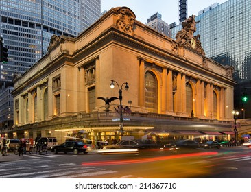 Wide angle view on the illuminated Grand Central Terminal at dusk during twilight with light trails on the streets representing the huge amounts of traffic in and around the station, in New York, USA