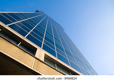 wide angle view on shiny blue glass skyscraper