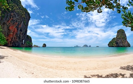 Wide angle view of the Phra Nang beach with the Princess Cave on the left and Koh Poda in the background.